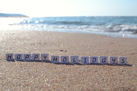Holiday sign on the beach sand word Stock fotó