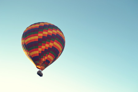 hot air balloon is flying at sunrise Stock fotó - 67463459
