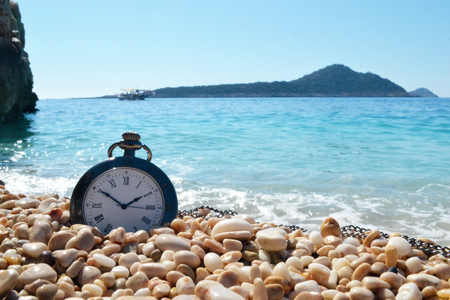 Vintage alarm clock with sunrise on the beach Stock fotó