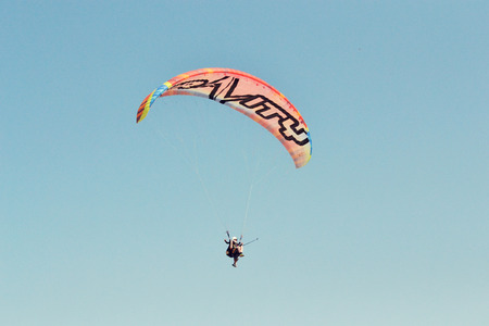Paraglider flying over mountains in summer day Stock fotó