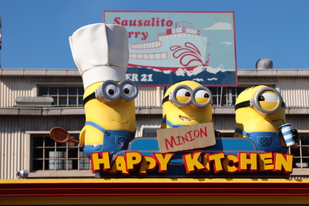 """OSAKA, JAPAN-FEB 11, 2016: Photo of """"HAPPY MINION KITCHEN"""" shop, selling Minion Chinese buns, located in Universal Studios, Osaka, Japan. Minions are famous character from Despicable Me animation."""