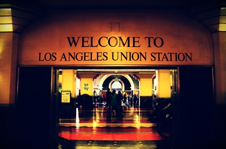 western united states: Los Angeles, USA-July 4, 2013. Passengers walking or sitting on chairs inside Union Station in Los Angeles, California. L. A. Union Station is located at 800 N. Alameda Street in Los Angeles. It is the largest railway station in the Western United States.