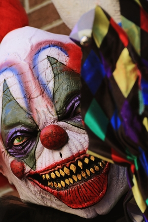 scary clown: Close up Halloween party horror clown. The scary clown standing