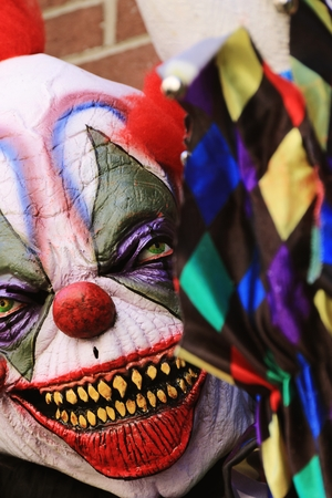 guadaña: Close up Halloween party horror clown. The scary clown standing