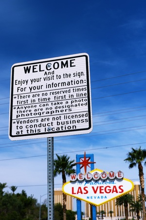 LAS VEGAS, NEVADA-07 OCT: A guide plate and The Welcome to Fabulous Las Vegas sign on bright sunny day in Las Vegas, Nevada USA, 07 Oct 2016