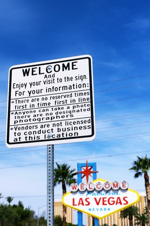 sin city: LAS VEGAS, NEVADA-07 OCT: A guide plate and The Welcome to Fabulous Las Vegas sign on bright sunny day in Las Vegas, Nevada USA, 07 Oct 2016