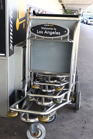 throughout: LAX, CA-7 October 2016-Editorial: SmarteCarte paying luggage carts await passengers at many airports throughout the United States