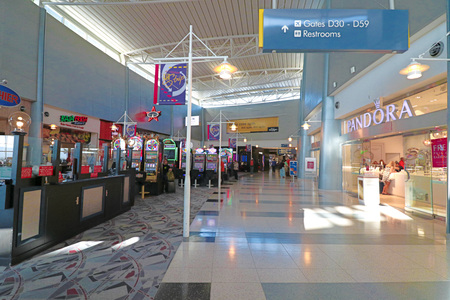 nv: NV-11 OCT 2016, LAS VEGAS-McCarran International Airport (LAS), located south of the Las Vegas strip, is the main airport in Nevada. There are slot machines in the airport.
