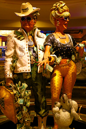 Las Vegas, NV, USA. Oct 10, 2016: couple statue of Harrahs Las Vegas hotel and casino. Harrahhi is a hotel and casino owned and operated by Caesars Entertainment Corporation. Editorial