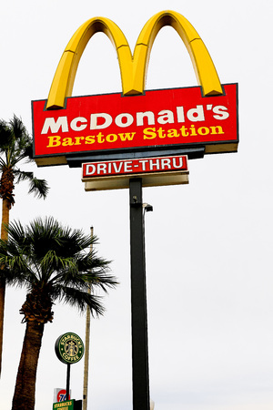 Barstow, California, USA-Oct 29, 2015: McDonalds logo on a pole. McDonalds is the worlds largest chain of hamburger fast food restaurants Editorial