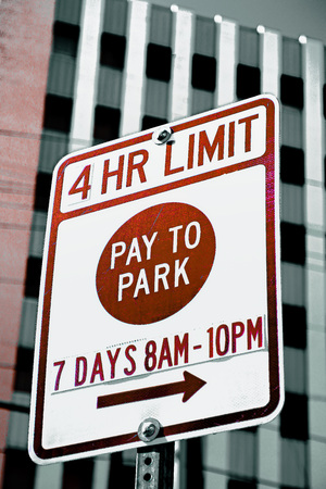 Pay to park sign in a city