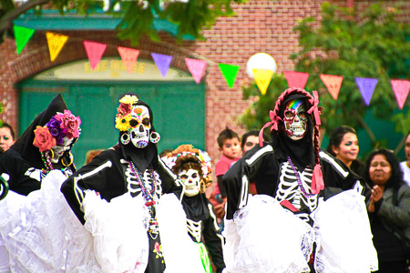 2013 DIA DE LOS MUERTOS in Olvera Street, LOS ANGELES, USA-Oct 27. Colorful, ancient Mexican ceremony in remembrance of departed loved ones with beautifully decorated altars entertainment.