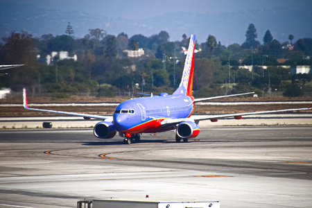 LOS ANGELES, CA-Sep 19, 2018: A Southwest Airlines passenger jet lands at Los Angeles International Airport in Los Angele s. Southwest carries 130 million passengers annually
