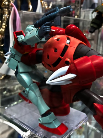 Osaka, Japan-Apr 13, 2019: Focused of Mobile Suit RGM-79 GM and MSM-07 Zugock (Red Comet) plastic model toys. The characters of the fictional Gundam universe by GUNDAM plastic model & BANDAI.