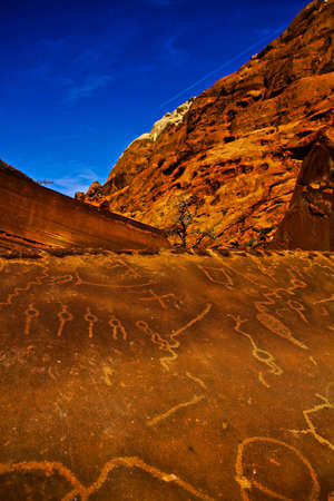 Ancient Native American Petroglyphs on Sandstone Rock in Red Rock Canyon State Park National Conservation Area.