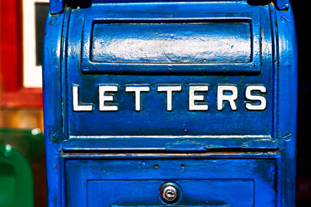 Antique Blue Letter Box on the Telegraph made of wood.Vintage metal mail box.Front view of Very Old (Vintage) big blue US Postal mail box.
