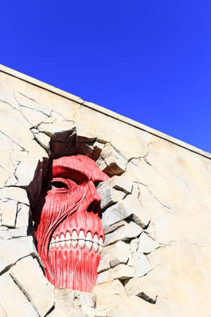 Osaka, Japan - March 26 , 2015 : Life size scale Statue of Wall giant from Attack on Titan (Shingeki no Kyojin) at Universal Studios Japan.