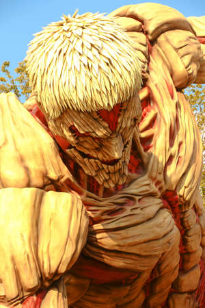 "Osaka, Japan-January 21, 2017: Life-size armor giant statue, from ""Attack on Titan""(Shingeki no Kyojin), Universal Studios Japan, Osaka, Japan"