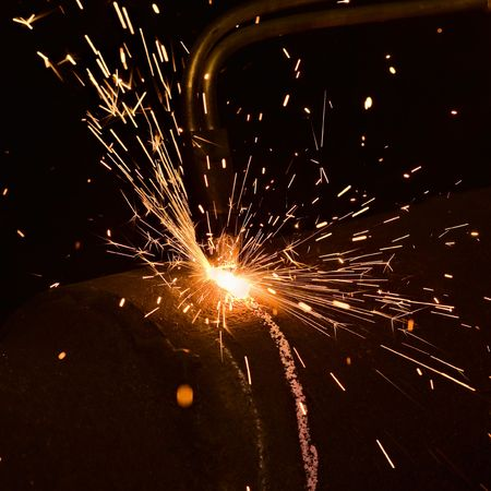 Sparks during the matel cutting photo