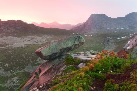 rainfall: Mountain landscape. Hanging stone under the sunset