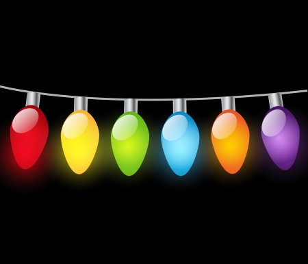 december holidays: Christmas light bulbs on dark background