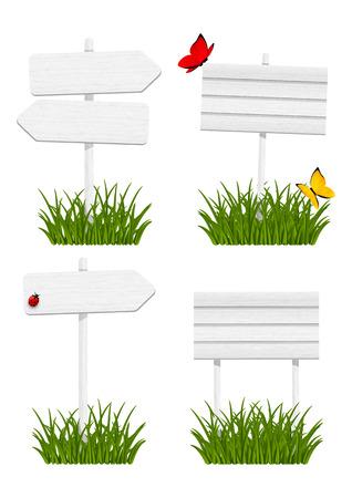 Conjunto de letreros de madera en la hierba verde Foto de archivo - 27786827