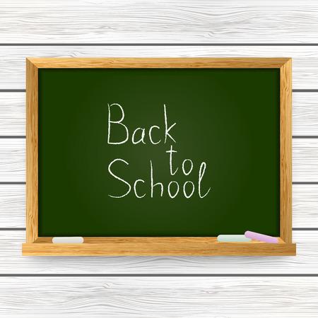 School chalkboard on wooden background