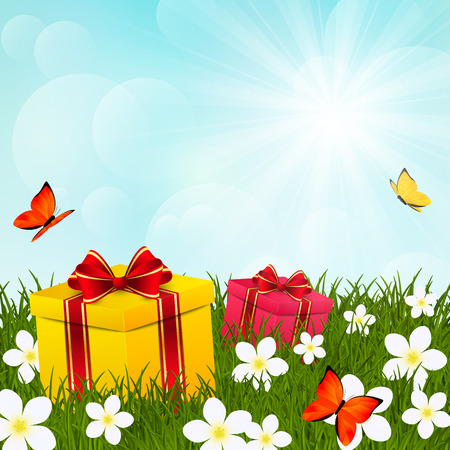 surprise box: Birthday gifts on green grass