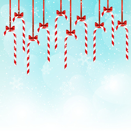 cane sugar: Christmas candies on blue sky background
