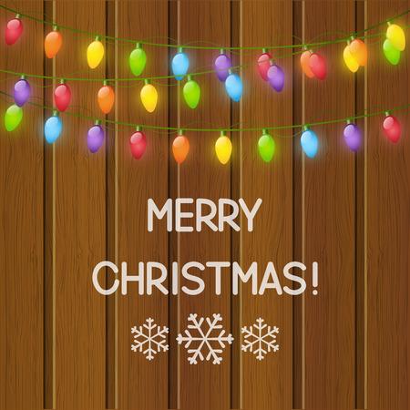 christmas bulbs: Christmas light bulbs on wooden background