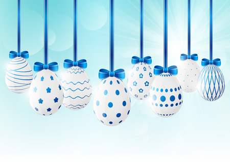 blue and white: Easter eggs on sunny background