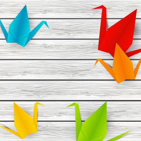 rainbow vector: Paper origami cranes on wooden background Illustration