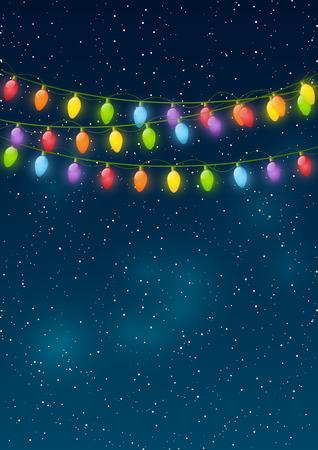 Christmas lights on night sky background