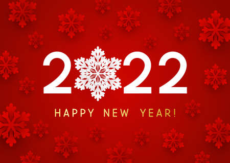 New Year concept - 2022 numbers on red background with paper snowflakes for winter holidays design