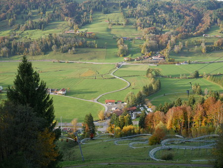 summer toboggan run in the bavarian alps on a sunny afternoon in autumn