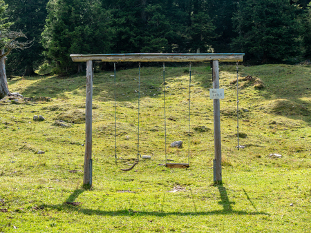 Construction of two swings in the landscape