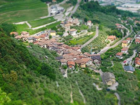 Tilt shift image of mountain village in italy near lake garda
