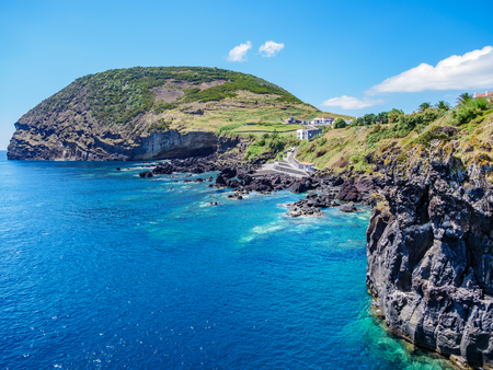 Image of cliff and landscape at the atlantic ocean on the island of sao jorge Azores Europe Portugal Standard-Bild