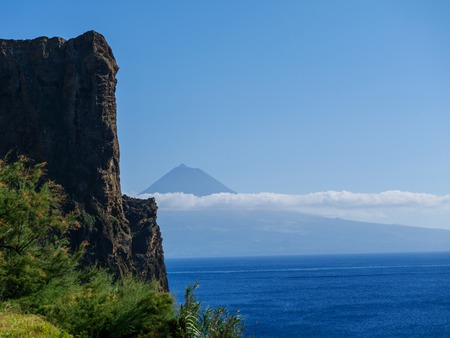 Image of landscape in the foreground and the mountain of Pico in the background Azores Portugal Europe