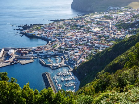 Image of city of Velas with habour on sao jorge with pico in the background Azores Portugal Europe
