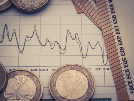 Image of money investment strategy with coins and euro bills close up Stock Photo