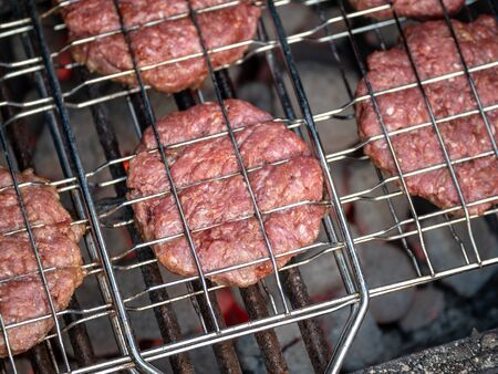 Image of bbq burger patties on grill Stock Photo