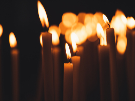 Image of many burning candles with shallow depth of field