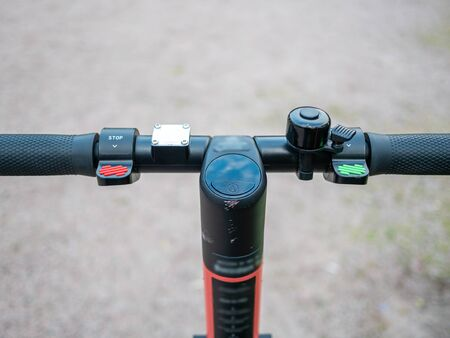 Close up image of an e-scooter handlebar with breaks, acceleration and a bell Stockfoto
