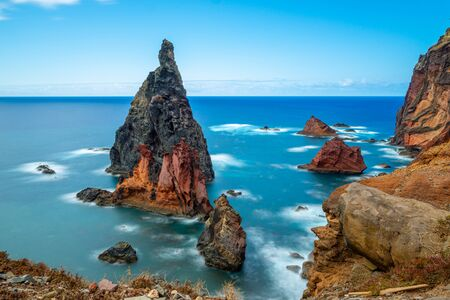 Long exposure image of a colorful rock in the atlantic sea on Madeira, Portugal Stockfoto