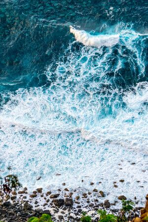 Top down view on waves at the shore Standard-Bild - 129368514