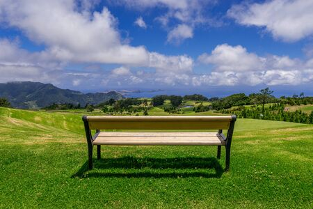 Park bench outdoor landscape. Wooden bench in golf course landscape. Mountain park bench panorama. Park bench relax, Madeira