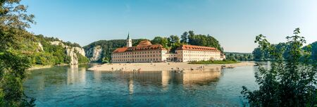 Panorama view on Weltenburg Abbey. This landmark is a Benedictine monastery in Weltenburg in Kelheim on the Danube in Bavaria, Germany. Banque d'images - 129369036