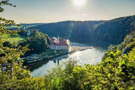Aerial view on Weltenburg Abbey. This landmark is a Benedictine monastery in Weltenburg in Kelheim on the Danube in Bavaria, Germany. Banque d'images - 129369230