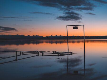 A beautiful sunset at Lake Ammer, Bavaria, Germany.
